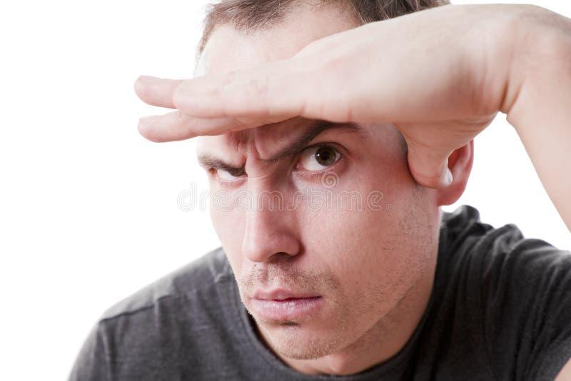 Homme sceptique méfiant photo stock