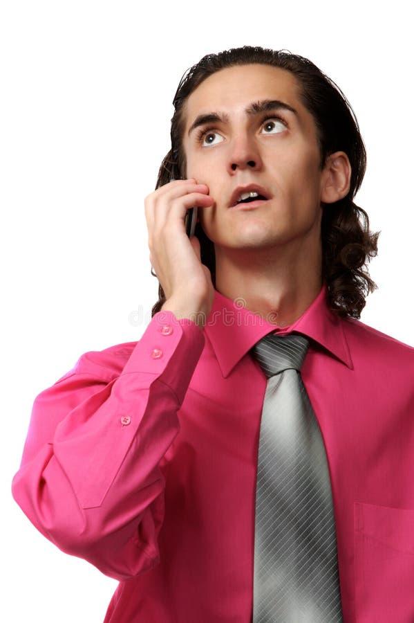Homme sexy d'affaires au téléphone image stock