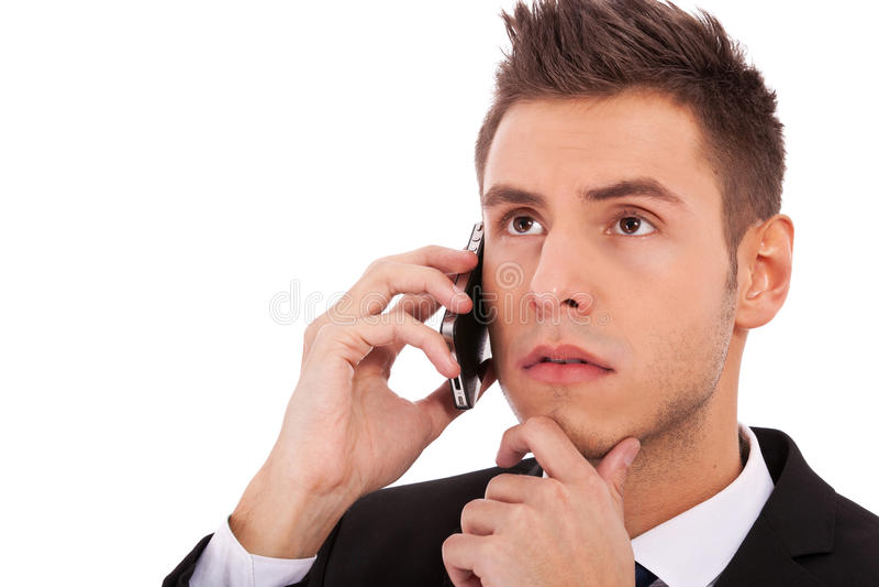 Homme songeur d'affaires au téléphone photographie stock libre de droits