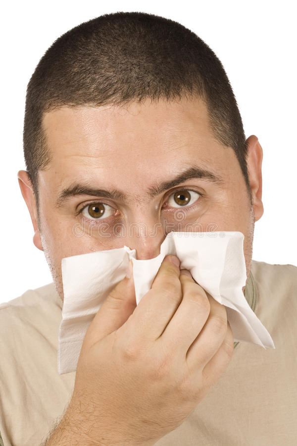 Homme soufflant son nez photos libres de droits