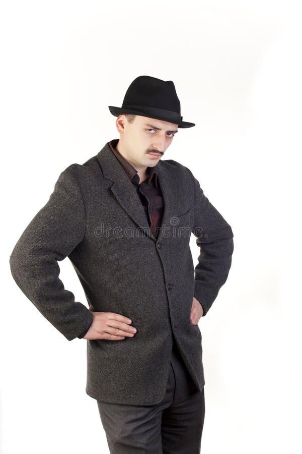 Homme soupçonneux dans le chapeau images libres de droits