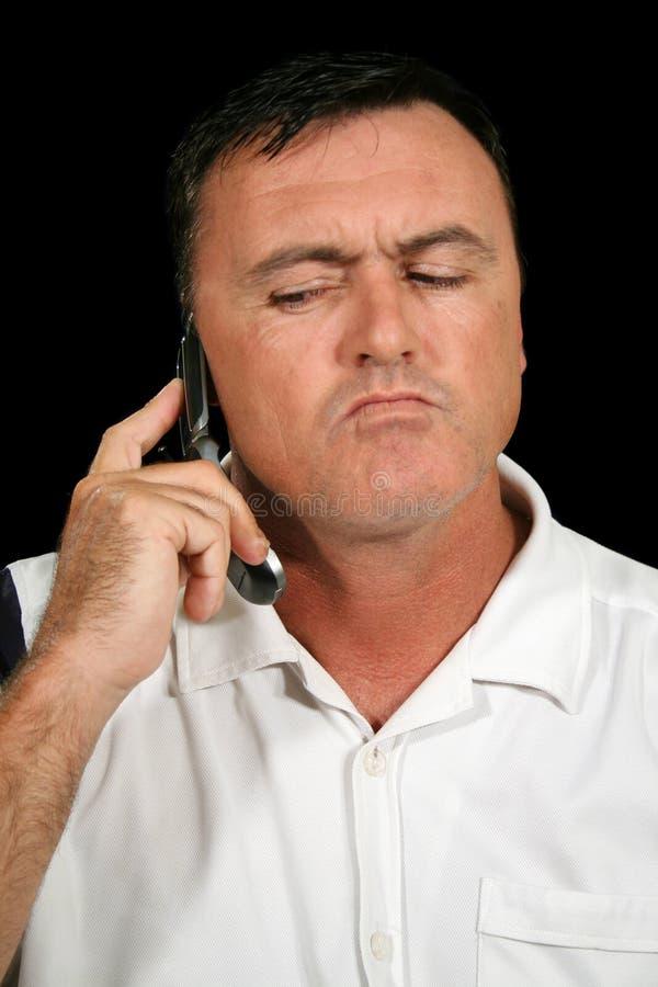 Homme soupçonneux de téléphone portable photo stock