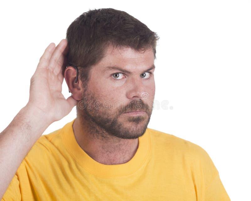 Homme sourd avec l'implant cochléaire photo libre de droits