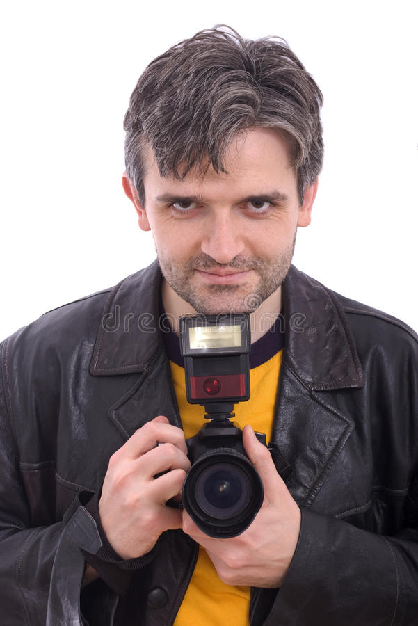 Homme souriant avec un appareil-photo de photo de SLR photographie stock libre de droits