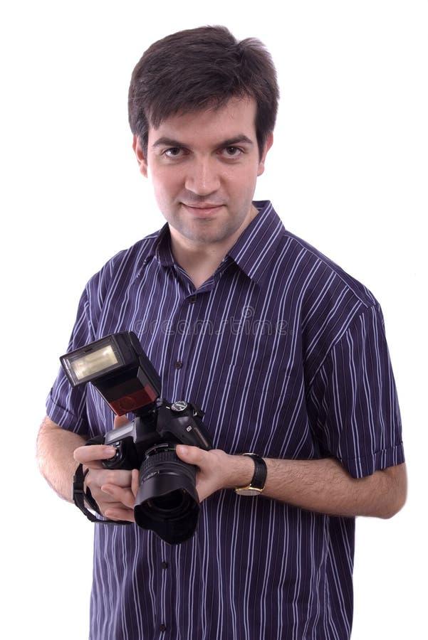 Homme souriant avec un appareil-photo neuf de photo de dSLR images libres de droits