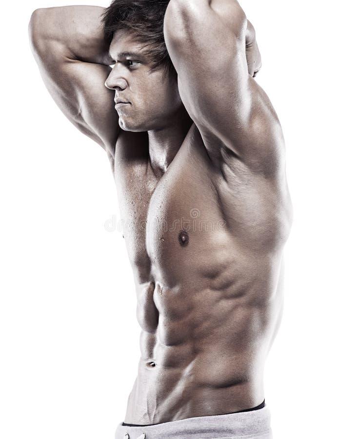 Homme sportif fort montrant le corps musculaire images libres de droits