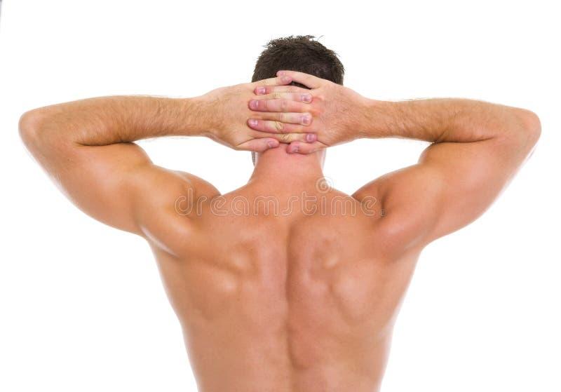 Homme sportif intense affichant le dos musculaire image stock