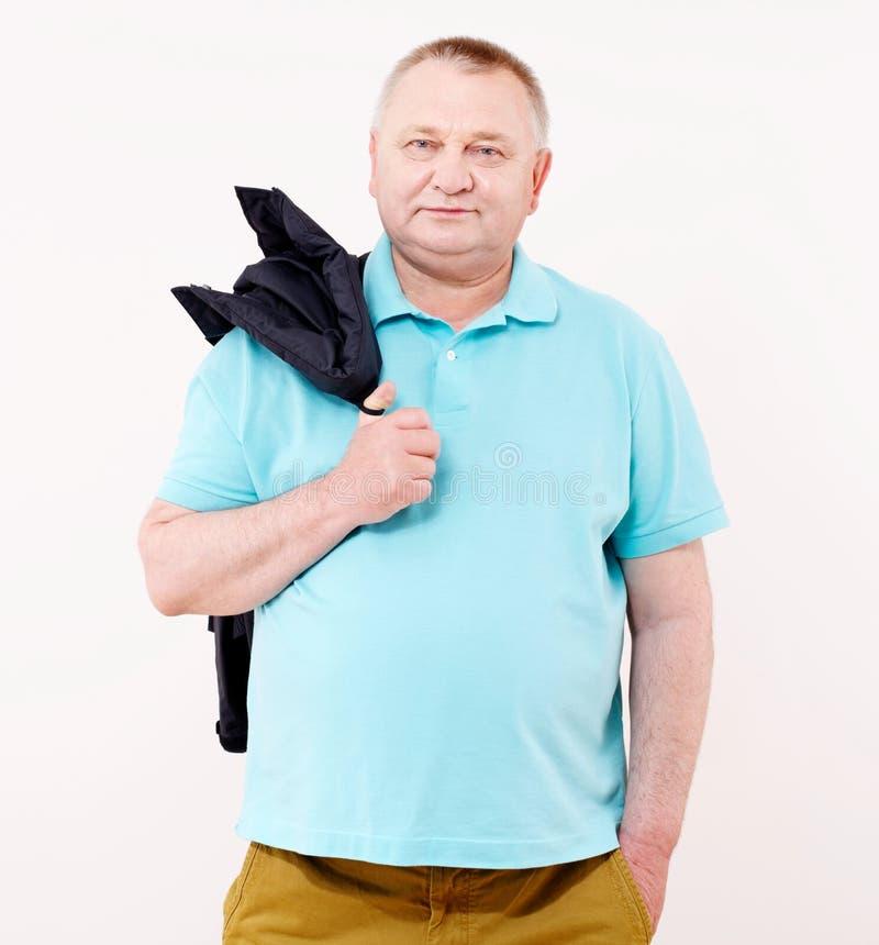 Homme supérieur avec la veste au-dessus du blanc photos stock