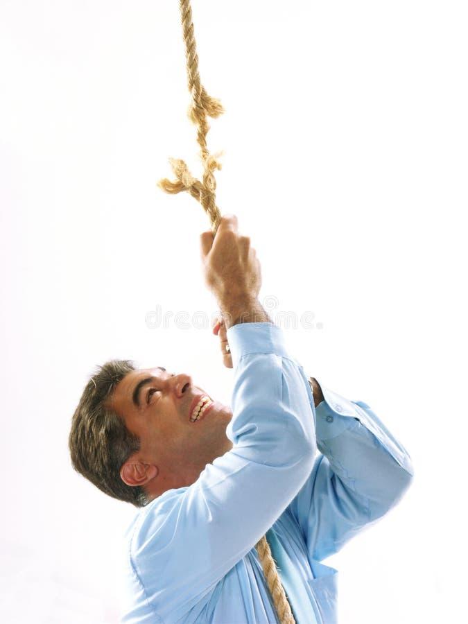 Homme sur la corde jointe image libre de droits