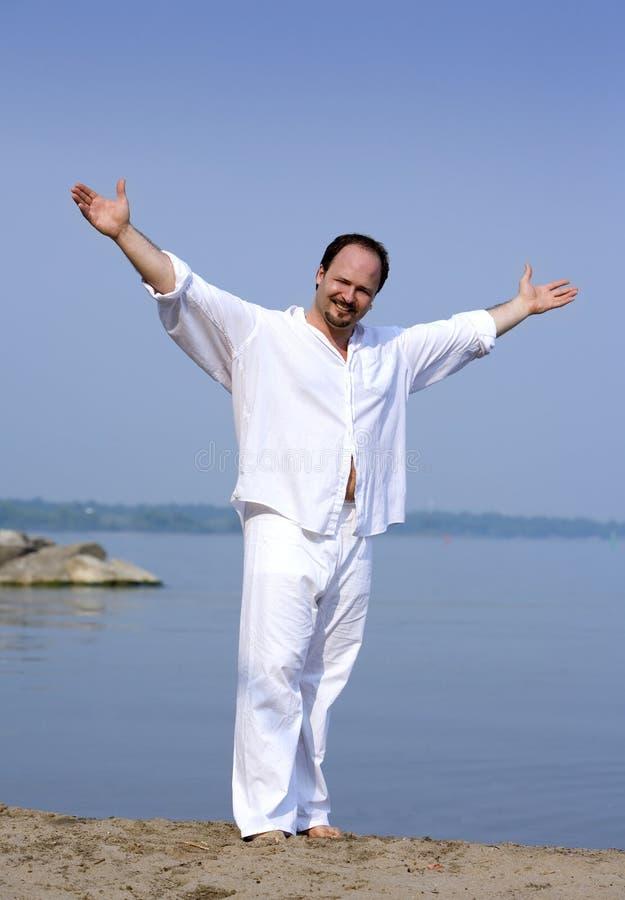 Homme sur la plage photos libres de droits