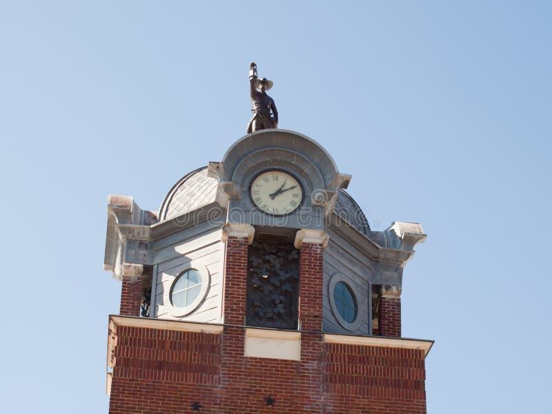 Homme sur la tour photo stock