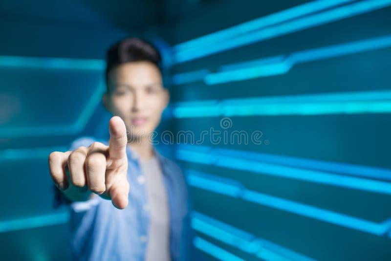Homme sur le fond de technologie image stock