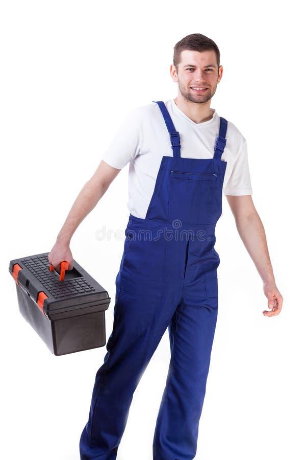 Homme tenant la boîte à outils image libre de droits