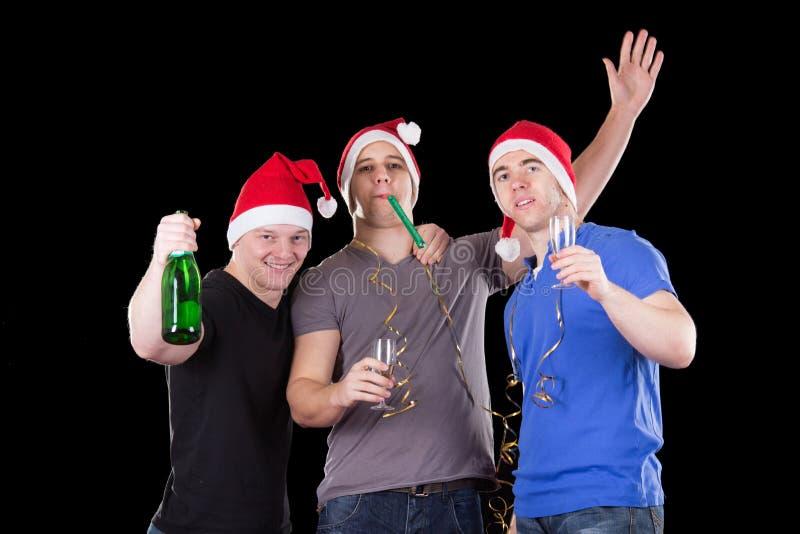 Homme trois utilisant le chapeau de Santa photo stock