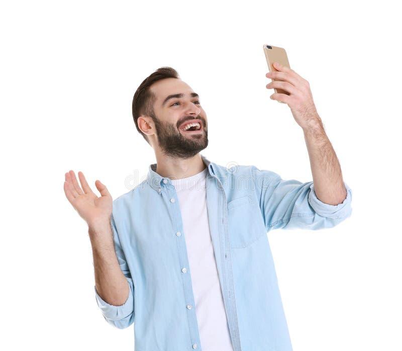 Homme utilisant le t?l?phone portable pour la causerie visuelle photo stock