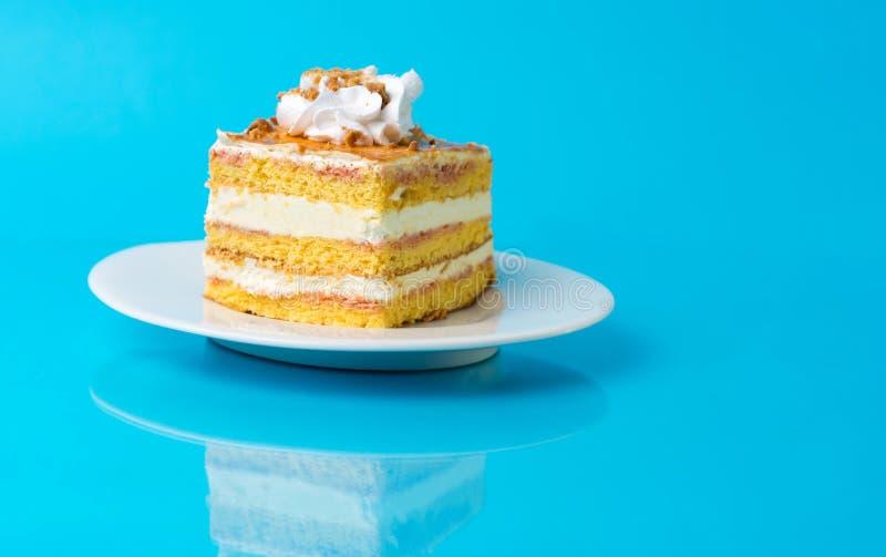 Hommemade banana cake slice on a plate. Hommemade banana cake slice on a white plate stock image