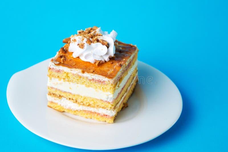 Hommemade banana cake slice on a plate. Hommemade banana cake slice on a white plate royalty free stock image