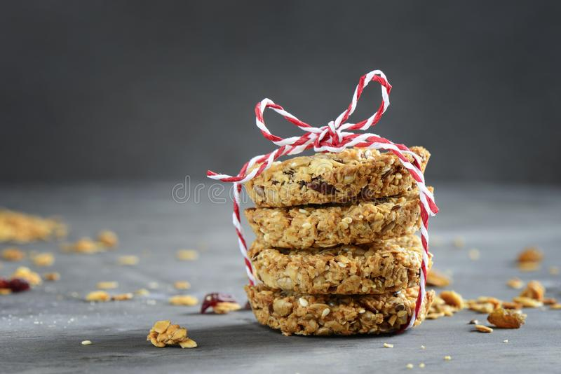 Hommemade granola put in a stack. Granola pieces put in a stack and twined like a small present, homemade simple healthy snack stock image