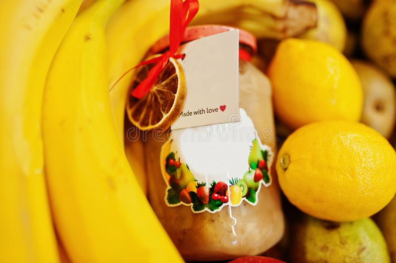 Hommemade jar with bananas on the shelf of a supermarket or grocery store. Made with love.  royalty free stock photos