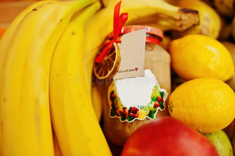 Hommemade jar with bananas on the shelf of a supermarket or grocery store. Made with love.  royalty free stock image