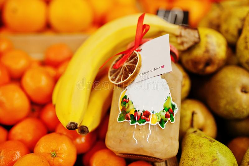 Hommemade jar with bananas on the shelf of a supermarket or grocery store. Made with love.  royalty free stock photography
