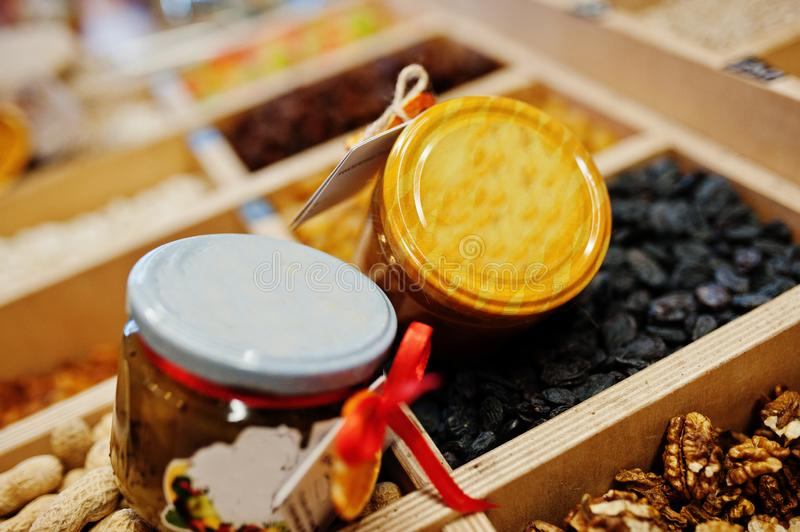 Hommemade jar with jam with nuts on the shelf of a supermarket or grocery store. Made with love.  stock image