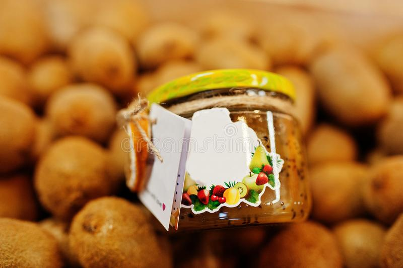 Hommemade jar with kiwi on the shelf of a supermarket or grocery store. Made with love.  stock photo