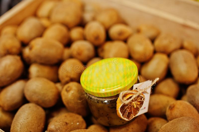 Hommemade jar with kiwi on the shelf of a supermarket or grocery store. Made with love.  stock photography