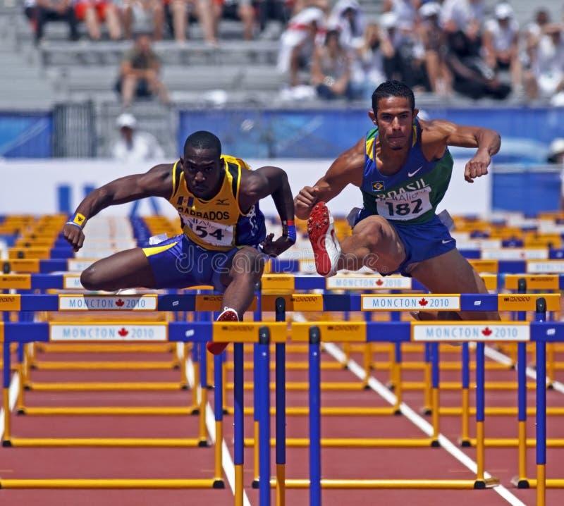 hommes Barbade Brésil d'obstacles de 110 mètres photographie stock libre de droits