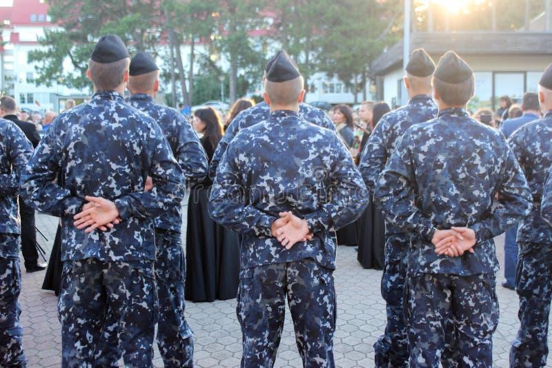 Hommes bleus d'armée images libres de droits
