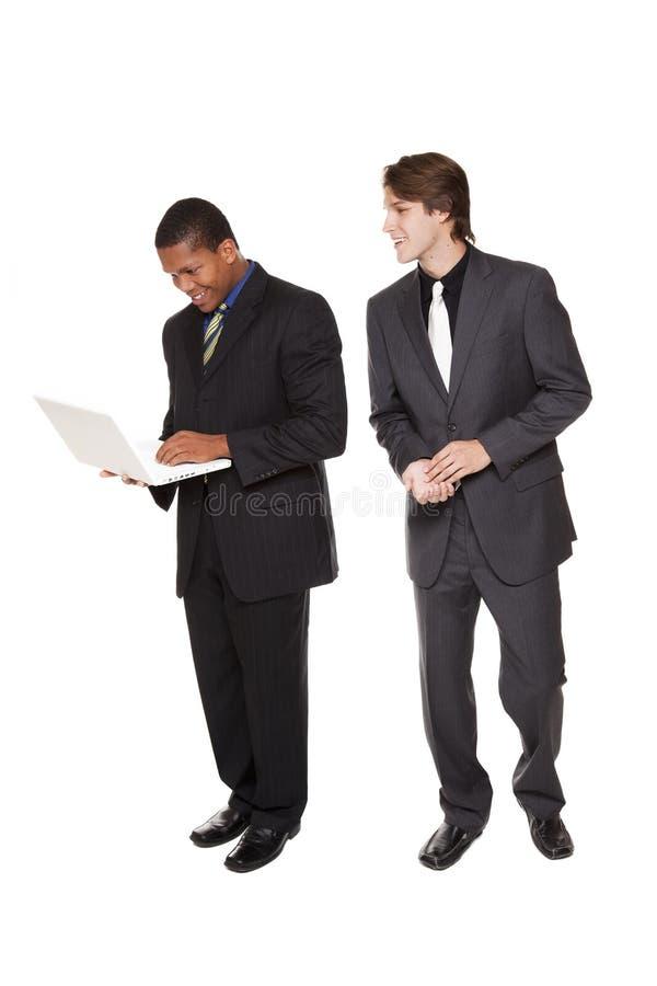 Hommes d'affaires - équipe heureuse d'ordinateur portatif images stock