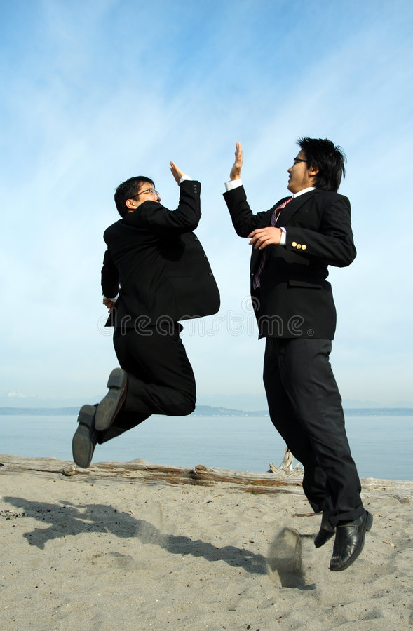 Hommes d'affaires heureux photographie stock