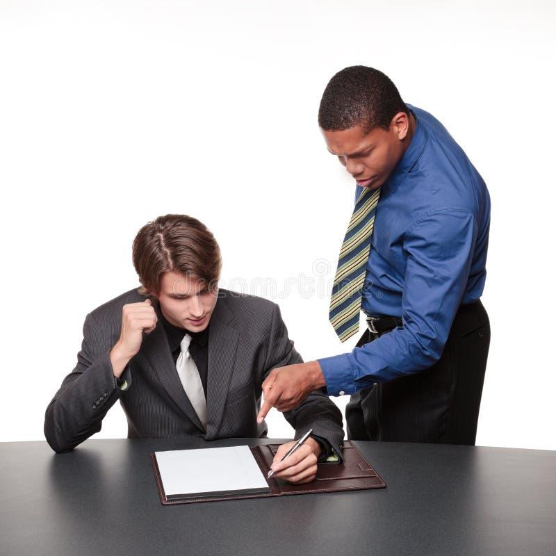 Hommes d'affaires - notes de conférence images stock