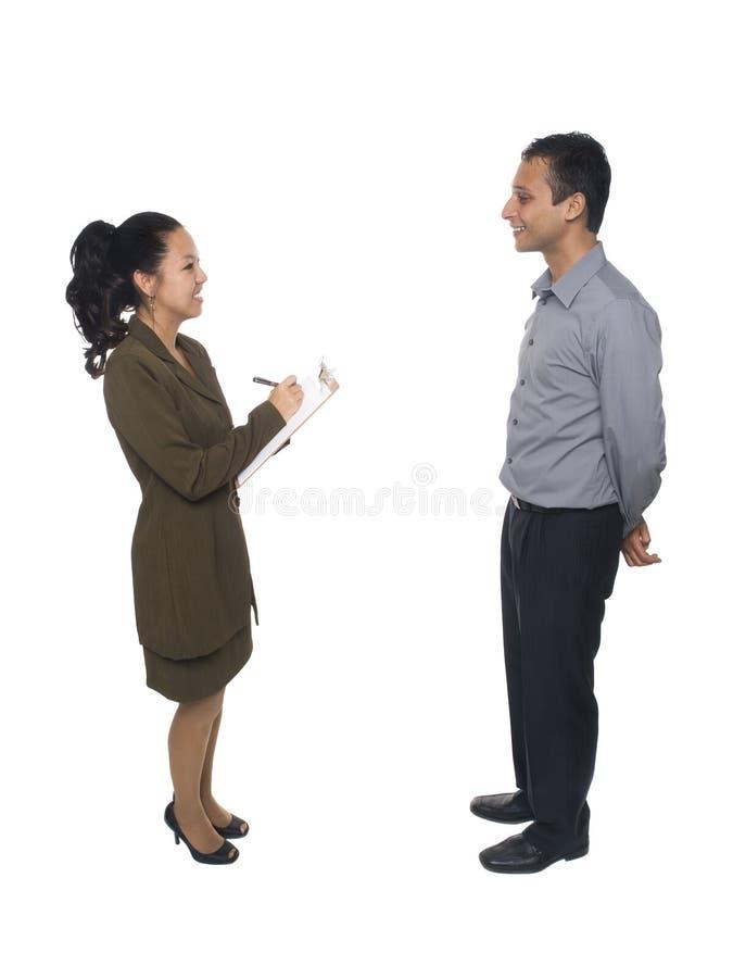 Hommes d'affaires - questionnaire d'entrevue photo stock