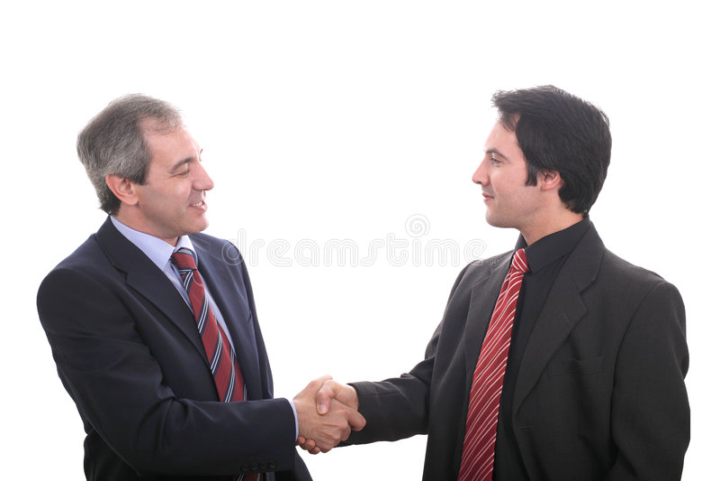 Hommes d'affaires se serrant la main photographie stock libre de droits