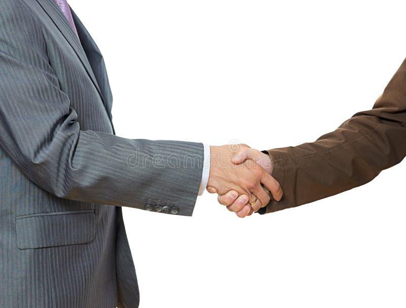 Hommes d'affaires se serrant la main image stock