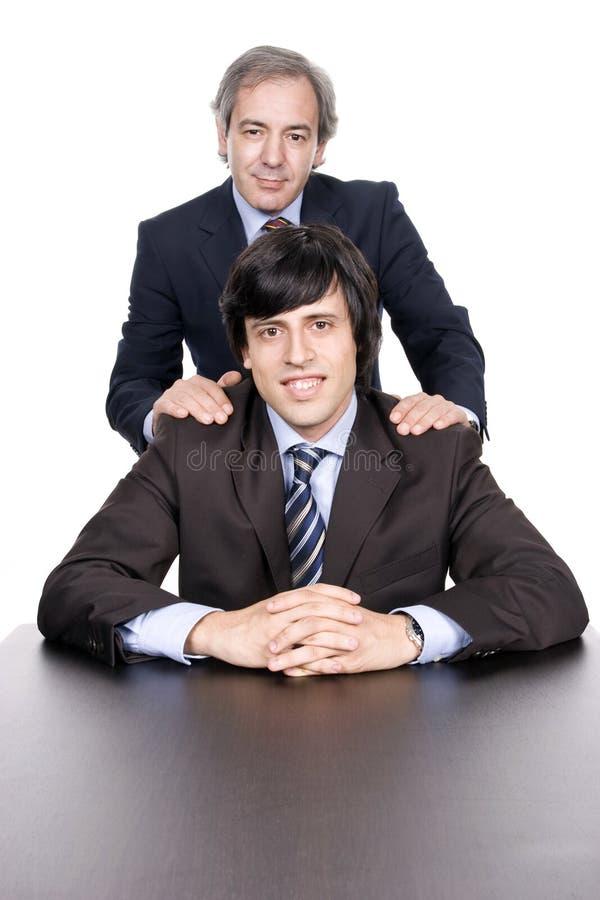 Hommes d'affaires verticale, père et fils photographie stock libre de droits