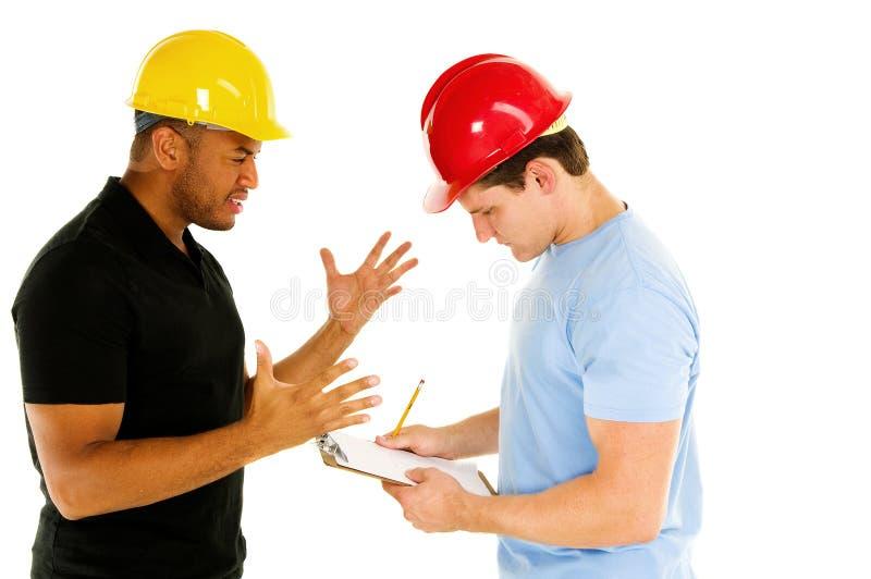 Hommes de construction photos libres de droits