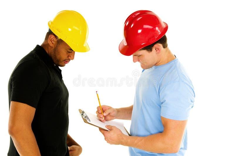 Hommes de construction images libres de droits
