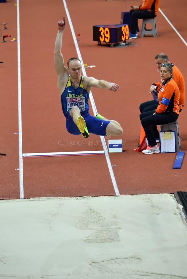 Hommes de long saut -1 images stock