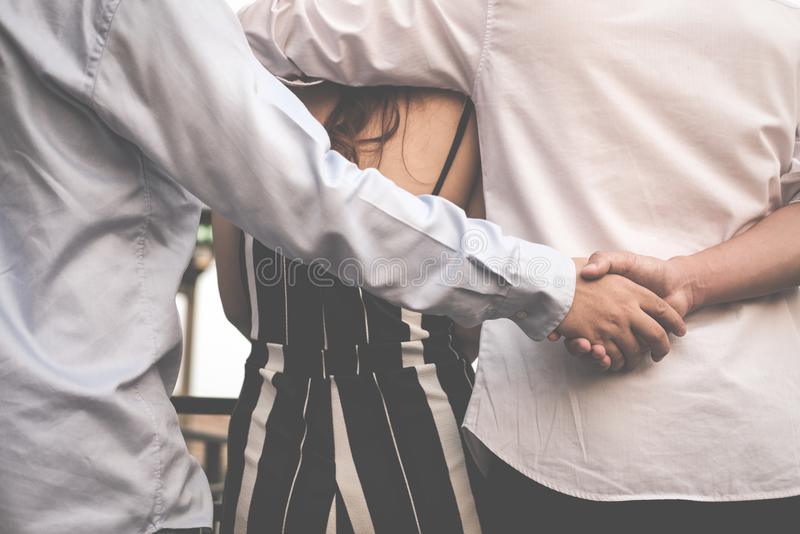 Homosexual man hug woman while holding hands with secret lover. Gay couple in love triangle. boyfriend cheating on girlfriend. same sex and homosexuality royalty free stock photos