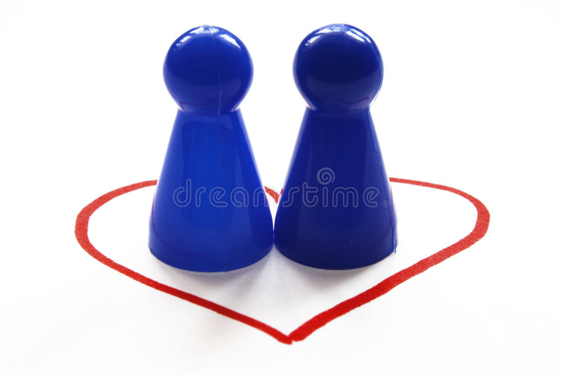 Homosexuality. Two blue game figurines in a heart, symbolizing the concept of same-sex love, homosexuality stock image