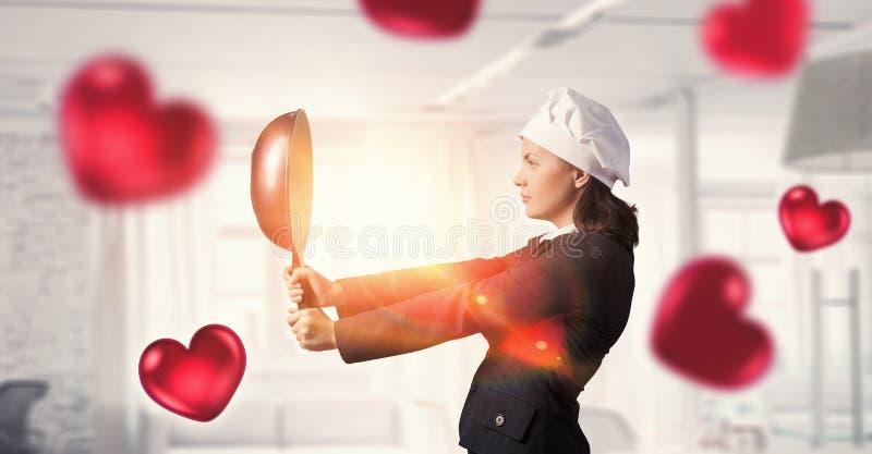Hon ska laga mat förälskelse Blandat massmedia royaltyfria foton