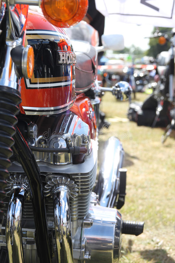 Honda CB 750 Four, engine and petrol tank. Honda CB 750 Four motorcycle, engine and petrol tank. Chrome and shining paint, exhaust and engine finning stock images