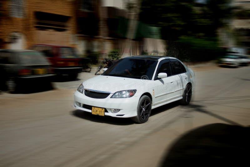 Honda Civic Car Panning Photo. Car Panning photography at North Nazimabad Karachi. The Motion blur effect of moving car stock photos