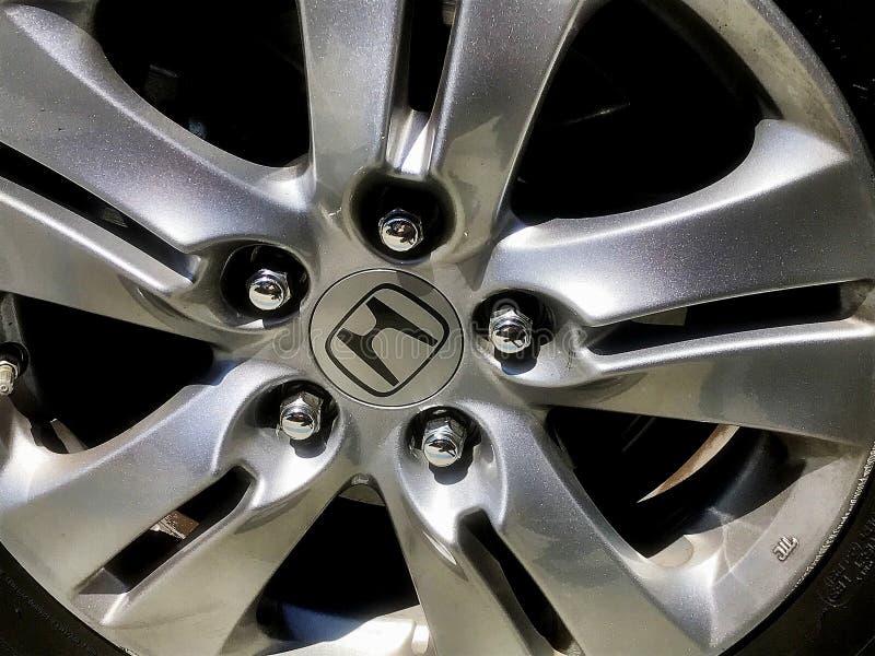 Honda hubcap. Hubcap with a honda logo royalty free stock photography