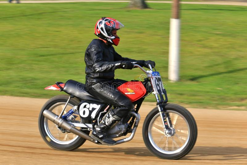 Honda Motorcycle. Honda sport bike races the track at the pro motorcycle racing event on the dirt oval track speedway, Ashland County, Ohio, USA royalty free stock images