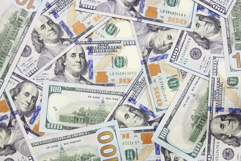 Honderd dollar bankbiljettenachtergrond stock foto's
