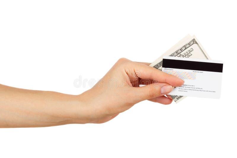 Honderd dollars in de vrouwen` s hand stock afbeeldingen