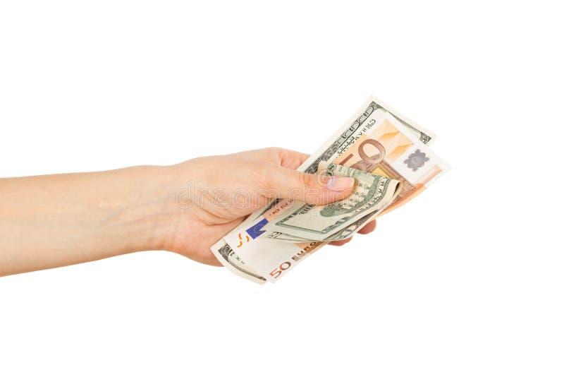Honderd dollars en Vijftig euro in de vrouwen` s hand royalty-vrije stock foto's